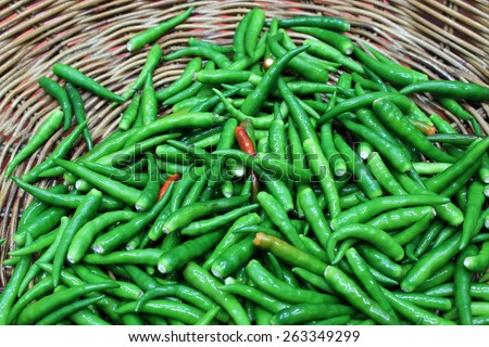 Fresh green paprika,very hot and spicy chilli peppers on background - stock photo