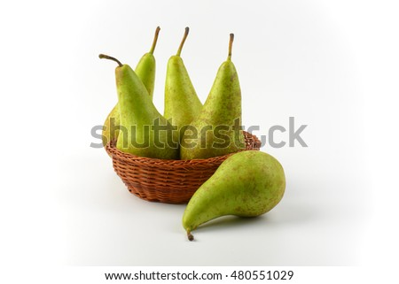 fresh green pears in wicker bowl