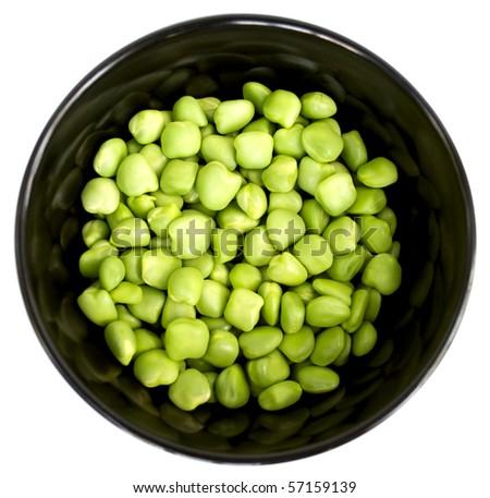 Fresh green peas in a beautiful black plate - stock photo