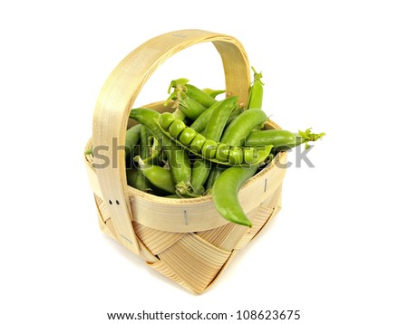fresh green peas in basket on a white background - stock photo