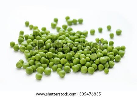 Fresh green peas isolated on white - stock photo