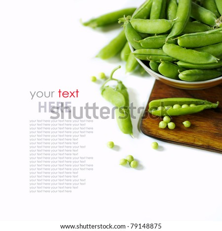 fresh green peas isolated on white background - stock photo