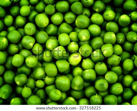 Fresh green peas macro texture high contrasted with vignetting effect background