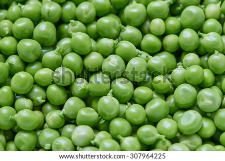 Fresh green peas natural food background - stock photo
