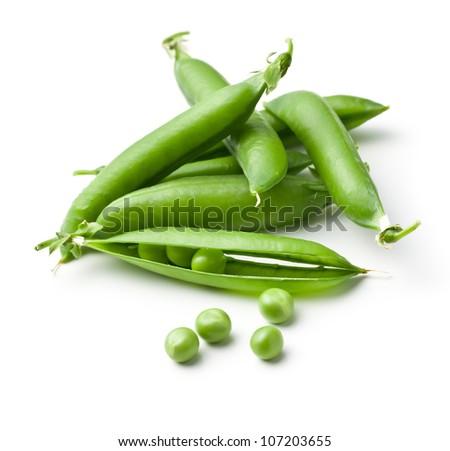 fresh green peas on white background - stock photo
