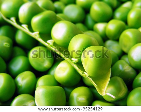 Fresh green peas. Selective focus. - stock photo