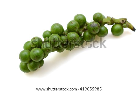 fresh green peppercorns isolated on a white background