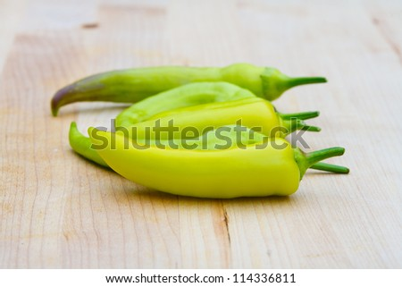 Fresh Green Peppers on Cutting Board - stock photo