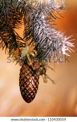 Fresh green pine branches and a gold bump - stock photo