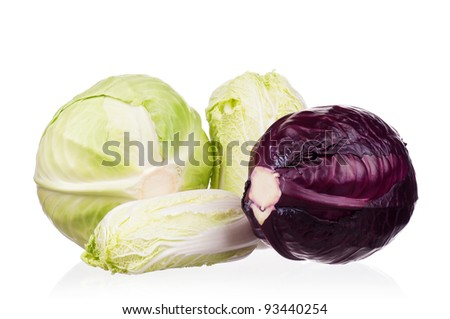 Fresh green, red, and Chinese cabbage vegetables on white background - stock photo
