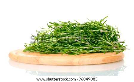 fresh green rosemary on wooden board isolated on white