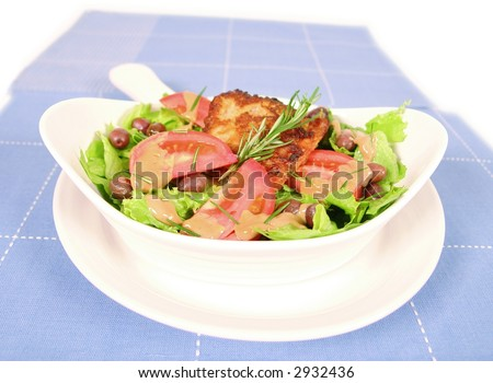 Fresh green salad with chunks of codfish