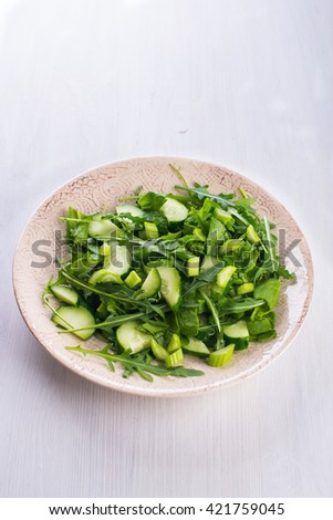 Fresh green salad with onions, celery, spinach