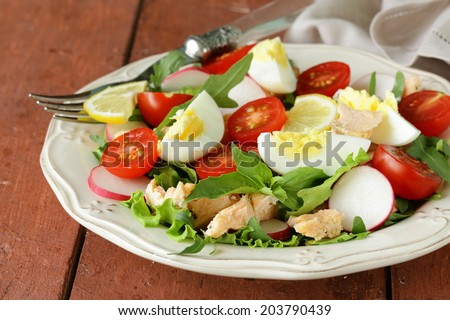 fresh green salad with salmon and tomatoes - stock photo