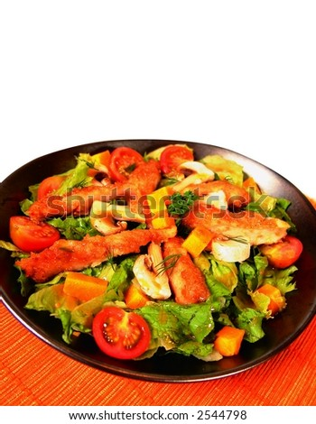 Fresh green salad with tomato and chicken