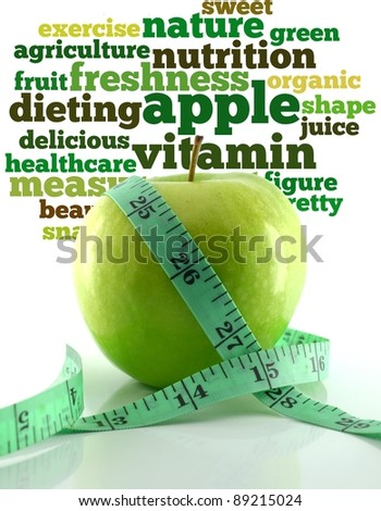 Fresh green tasty apple and measuring tape with info-text graphics and arrangement concept on white background (word cloud)
