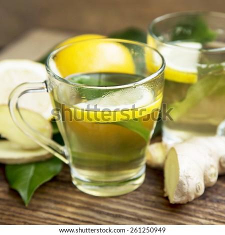 Fresh Green Tea with Lemon in Transparent Cups, Healthy Detox Tea - stock photo