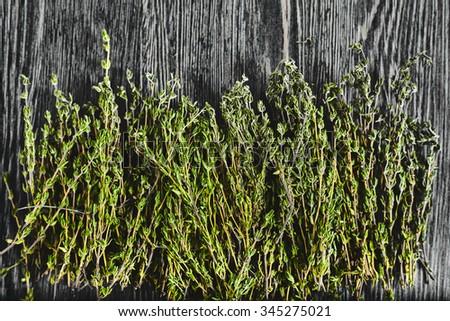 Fresh green thyme on dark wood backround  - stock photo