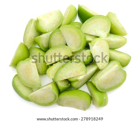 fresh green tomatoes sliced on white background