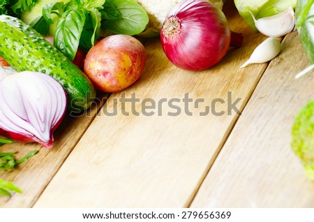 Fresh green vegetable set on the rustic wooden table - stock photo