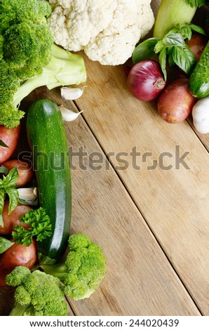 Fresh green vegetable set on the wooden table with copy-space - stock photo