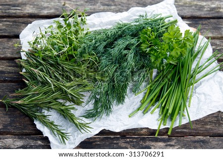 Fresh Green Vegetables Herbs.  Dill, Rosemary, Parsley, Chives and thyme. on old wooden table. - stock photo