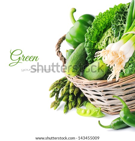 Fresh green vegetables in wicker basket - stock photo