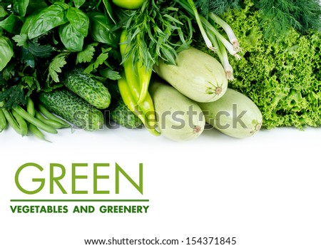Fresh green vegetables on a white background. - stock photo