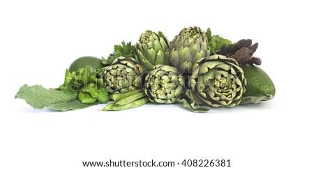 Fresh green vegetables  on white - stock photo