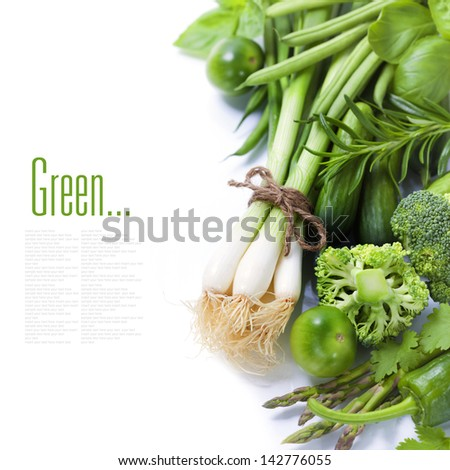 fresh green vegetables on white background (with easy removable sample text) - stock photo
