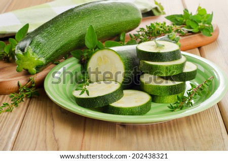 Fresh green zucchini  with herbs. Selective focus - stock photo