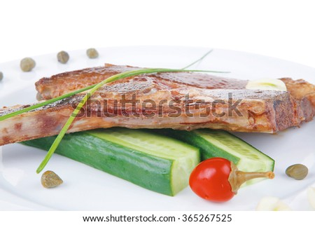 fresh grilled beef meat fillet on white plate with tomatoes and capers isolated  over white background . shallow dof - stock photo