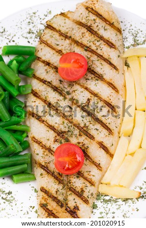 Fresh grilled fillet of pangasius. Isolated on a white background. - stock photo
