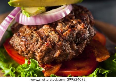 Fresh Grilled Paleo Hamburger with Veggies and Bacon - stock photo