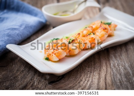 fresh grilled prawns with cilantro and parsley sauce - stock photo
