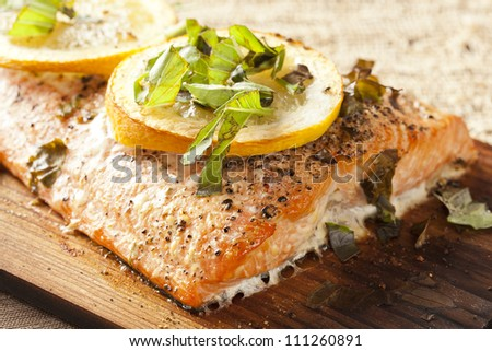 Fresh Grilled Salmon on a wooden plank - stock photo