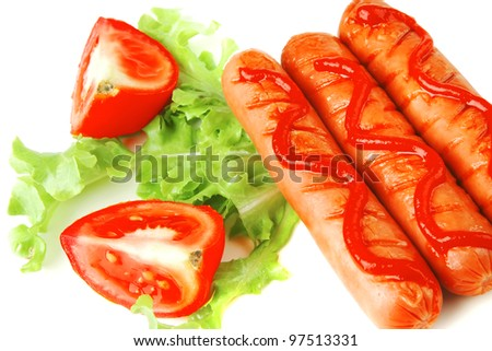 fresh grilled sausages served with tomato and ketchup - stock photo