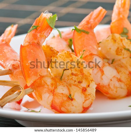 Fresh grilled shrimps  on white plate - stock photo