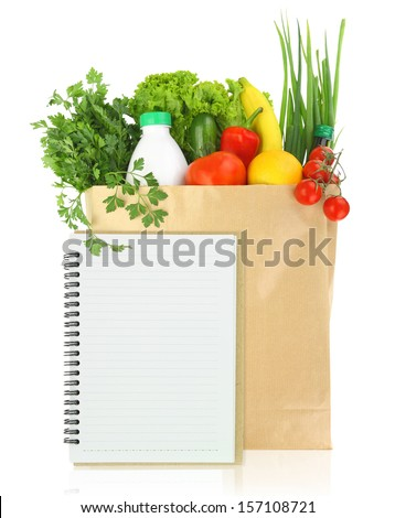 Fresh groceries in a paper bag  - stock photo