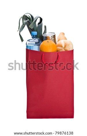 Fresh groceries in a Red bag. Including bread, orange, water, can and leek - stock photo