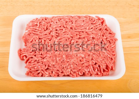 Fresh ground beef in a polystyrene tray - stock photo
