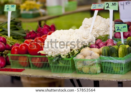Fresh grown vegetables at a local farmers market - stock photo