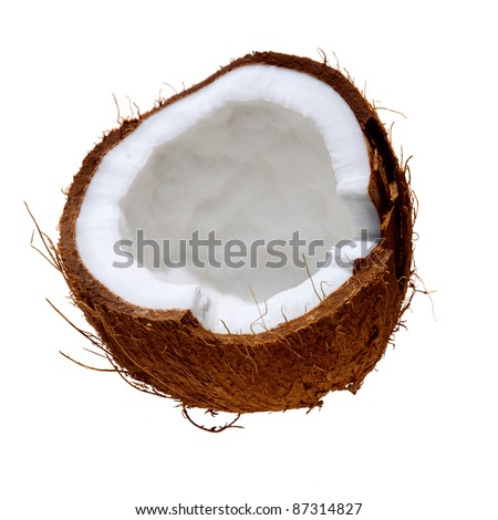 Fresh half coconut split shell showing flesh isolated on white background - stock photo