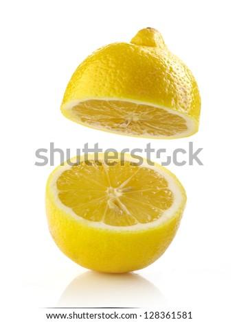 fresh half lemon on white background - stock photo