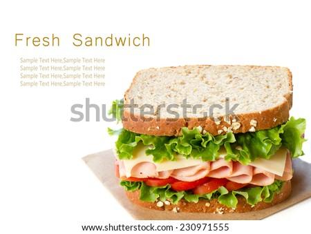 Fresh ham sandwich isolated on white - stock photo