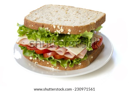 Fresh ham sandwich on a white plate,  isolated on white - stock photo