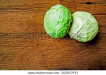 Fresh Harvest Green Cabbage on Wood Table Background, Food Rustic Still Life Style. - stock photo