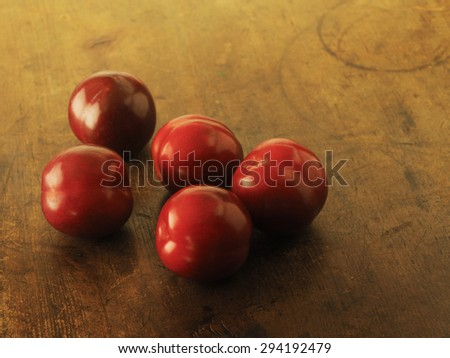 Fresh harvested plums, very ripe Plums on a old wooden table. Low key. - stock photo