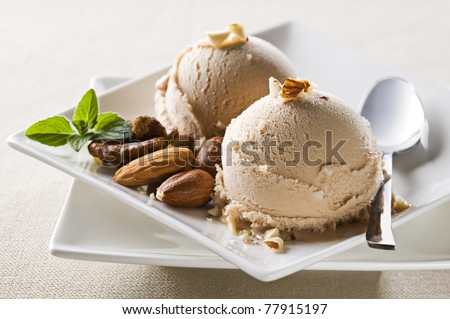 Fresh hazelnut ice cream on plate close up - stock photo