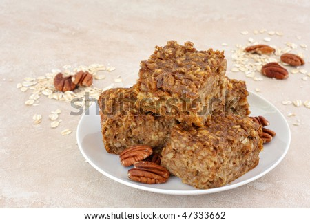 Fresh, healthy and homemade pumpkin pecan oatmeal snack bars. - stock photo